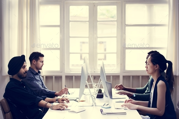 Co-workers working together - Stock Photo - Images