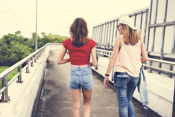 Rear view of women walking together - Stock Photo - Images