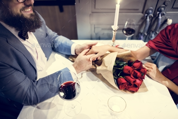 Man giving red rose bouquet - Stock Photo - Images