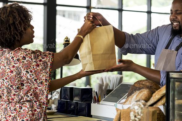 Black customer buying bakery products - Stock Photo - Images