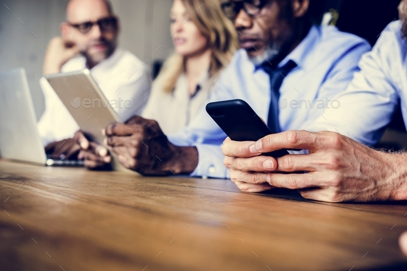 Business people in a meeting using devices - Stock Photo - Images