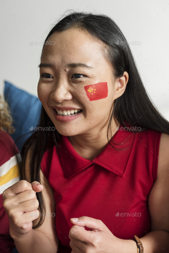 Friends cheering world cup with painted flag - Stock Photo - Images
