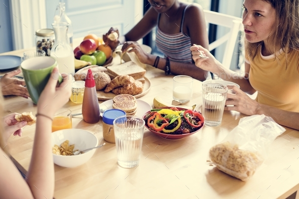 Group of diverse women having breakfast together - Stock Photo - Images