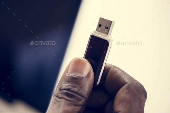 Hand holding Universal Serial Bus portable data backup - Stock Photo - Images
