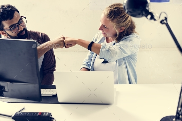 Computer technicians friends hit fists together - Stock Photo - Images