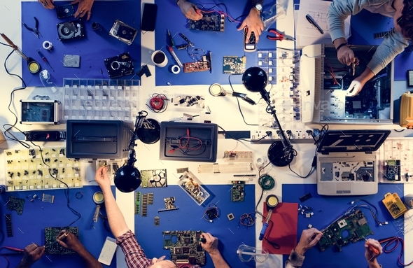 Aerial view of electronics technicians team working on computer parts - Stock Photo - Images