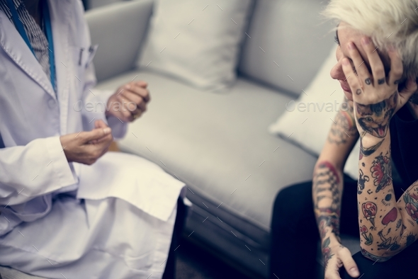 Depressed woman having a counseling session - Stock Photo - Images