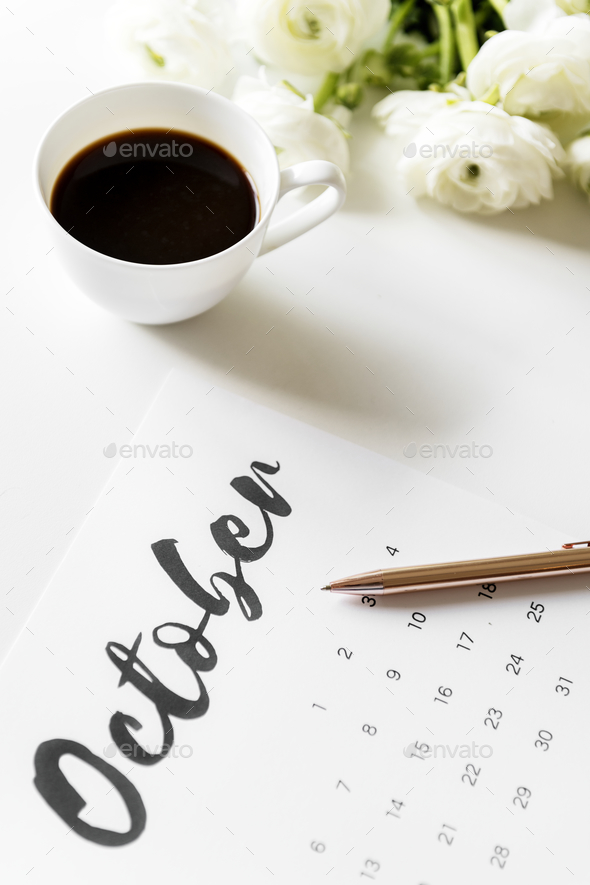 Aerial view of calendar with coffee cup - Stock Photo - Images