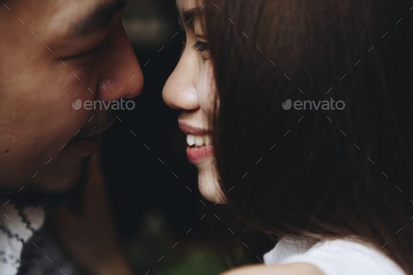Intimate romantic sweet asian couple - Stock Photo - Images