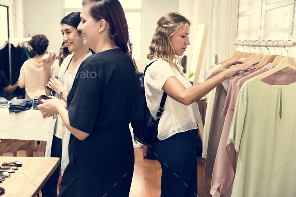 Customers checking out clothes - Stock Photo - Images
