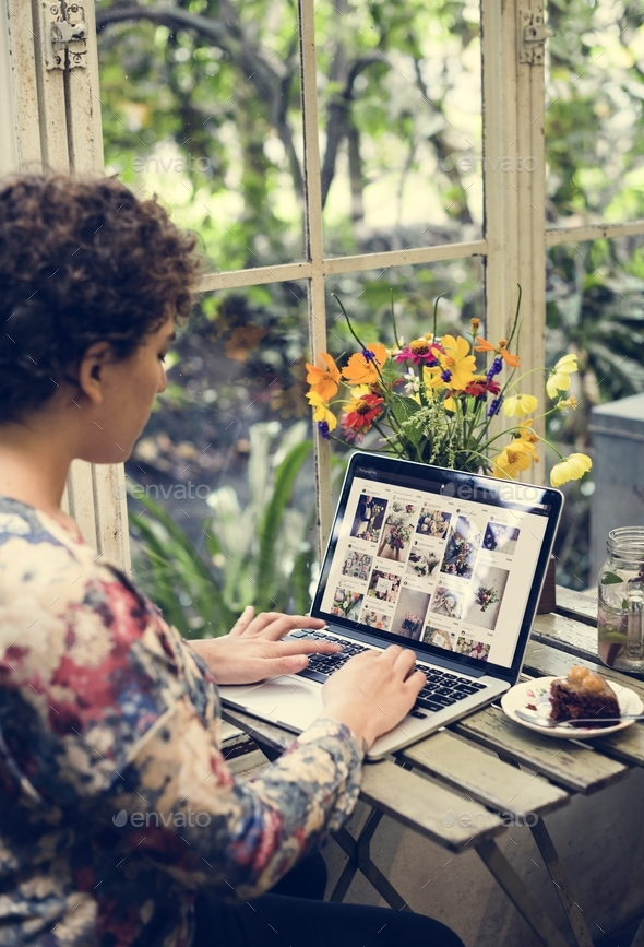 Woman using a laptop - Stock Photo - Images