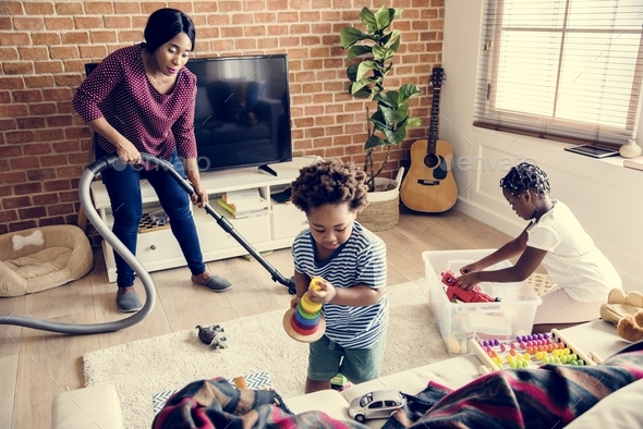 Black family cleaning the house together - Stock Photo - Images