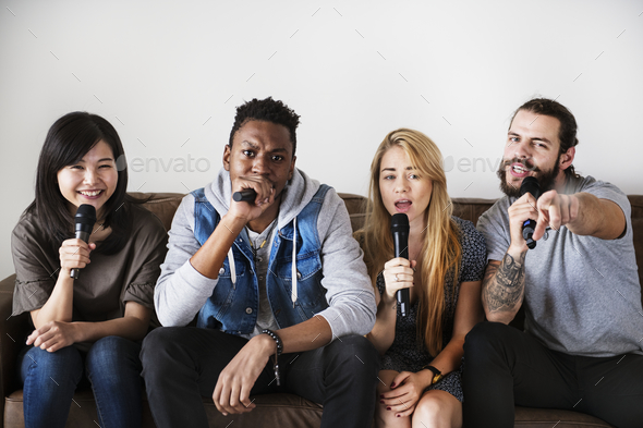 Friends at a karaoke - Stock Photo - Images