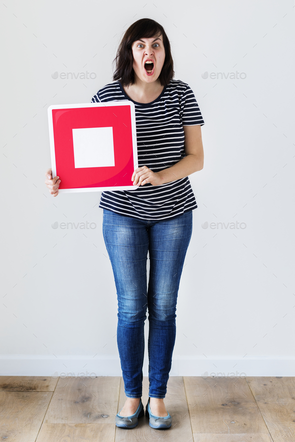 Caucasian woman holding a red stop icon - Stock Photo - Images