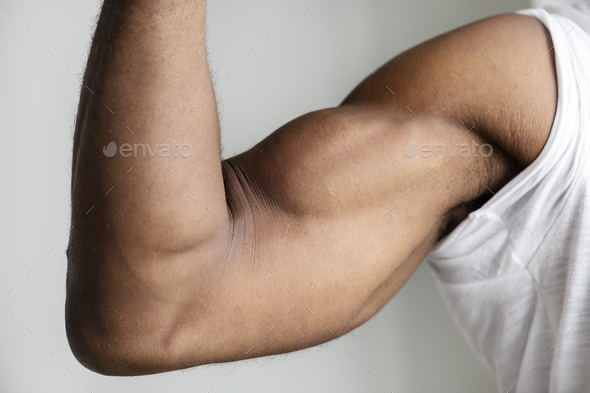 Closeup of a black person's muscular arm - Stock Photo - Images