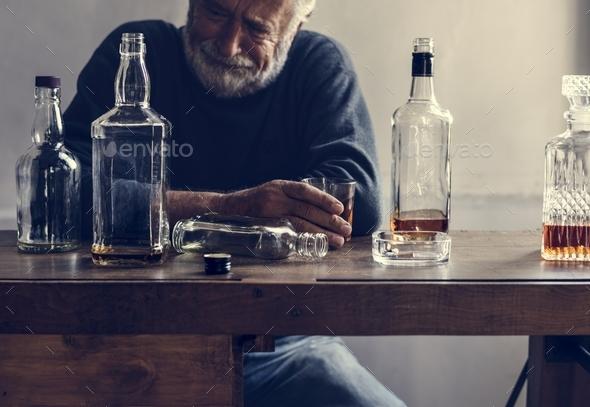 Elderly man drinking alcohol - Stock Photo - Images