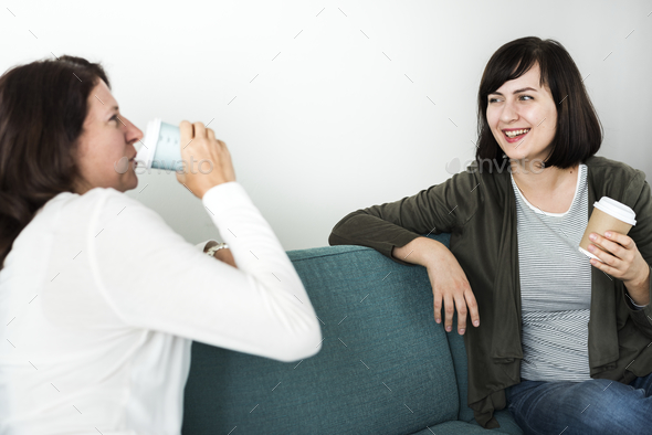 Women talking together on the couch - Stock Photo - Images