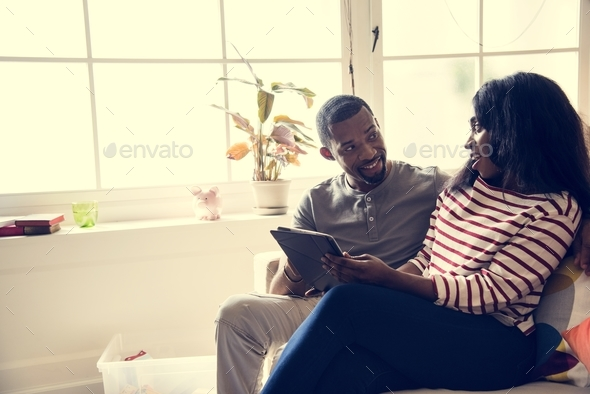 African couple working on tablet - Stock Photo - Images