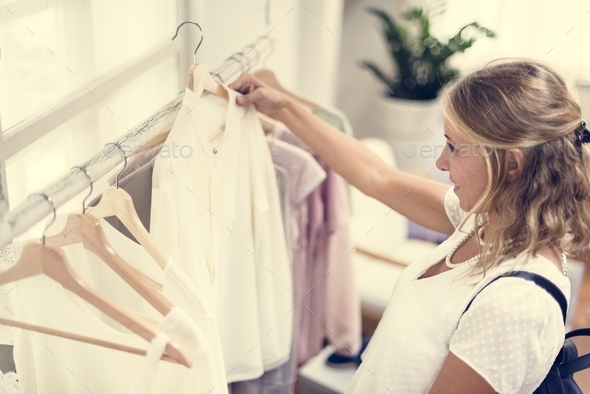 Woman checking out clothes - Stock Photo - Images