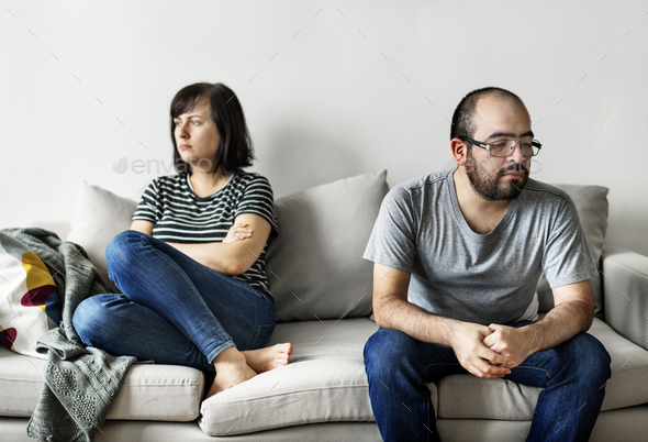 Unhappy couple arguing on the sofa - Stock Photo - Images