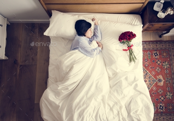 Woman sleeping and a bouquet of flower romance concept - Stock Photo - Images