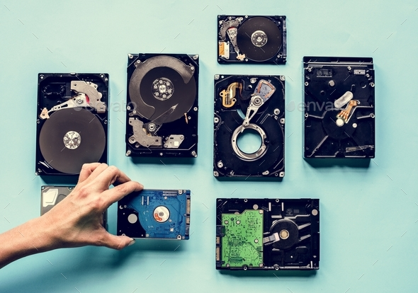 Hand holding HDD isolated on background - Stock Photo - Images