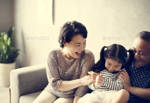 Asian family grandparent and niece playing togetehr - Stock Photo - Images