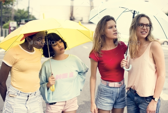 Group of diverse women with umbrella - Stock Photo - Images