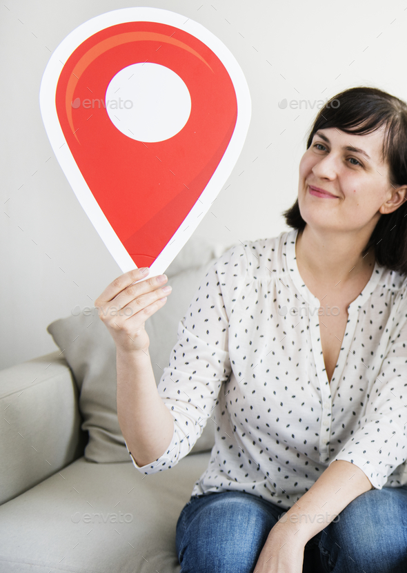 Woman holding travel pin - Stock Photo - Images