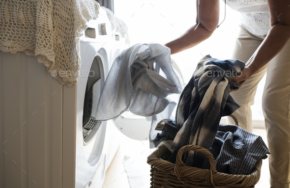 Elderly woman doing a laundry - Stock Photo - Images