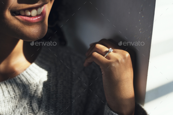 Cheerful woman with engagement ring - Stock Photo - Images