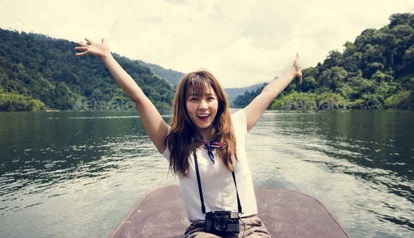 Asian woman enjoying an outdoor trip - Stock Photo - Images