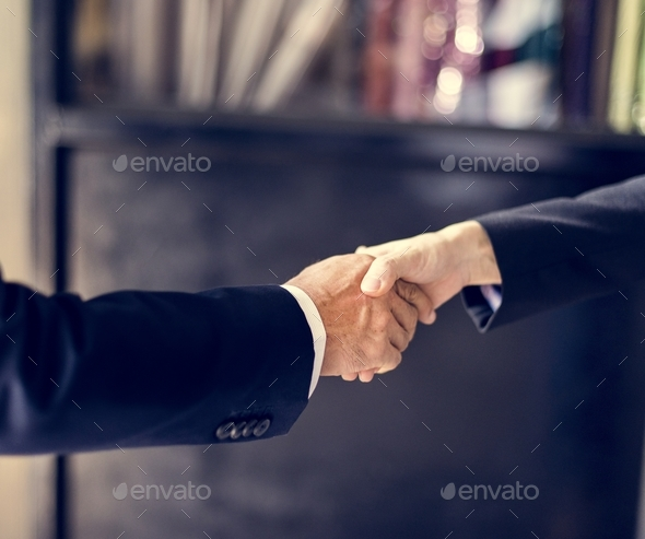 Close up of business people handshake - Stock Photo - Images