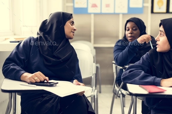 diverse muslim girls studying in classroom - Stock Photo - Images