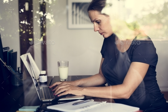 Pregnant woman is working - Stock Photo - Images