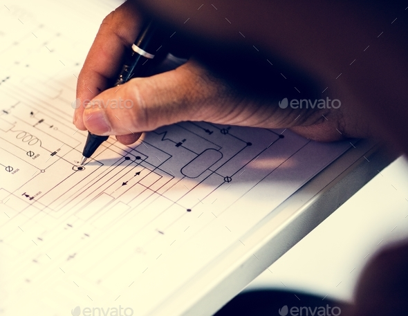 Hand drawing circuit pattern guide line on paper - Stock Photo - Images