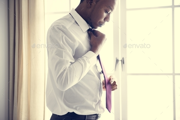 A man preparing to go to work - Stock Photo - Images