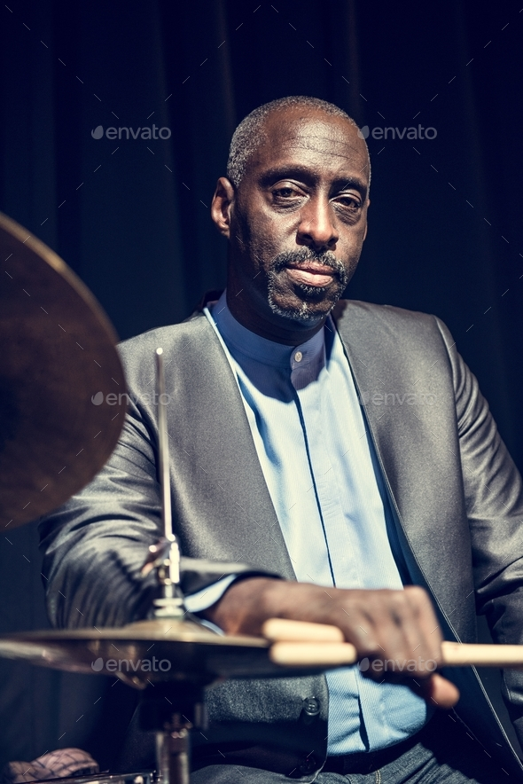 Drummer performing in an event - Stock Photo - Images