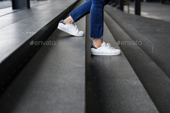 Closeup of person walking down the stairs - Stock Photo - Images