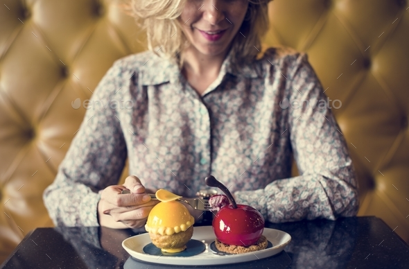 Woman with desserts at a cafe - Stock Photo - Images