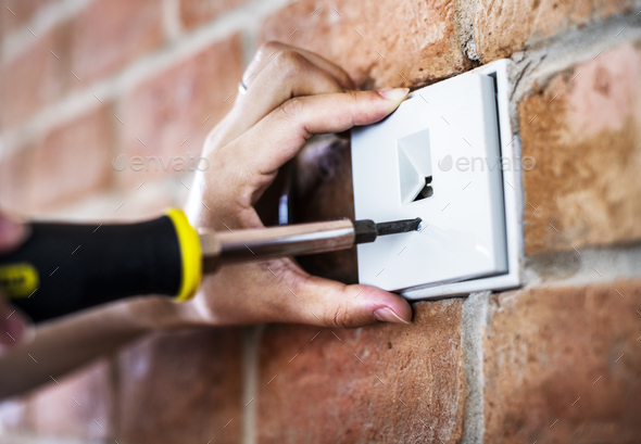 Closeup of switch installation - Stock Photo - Images