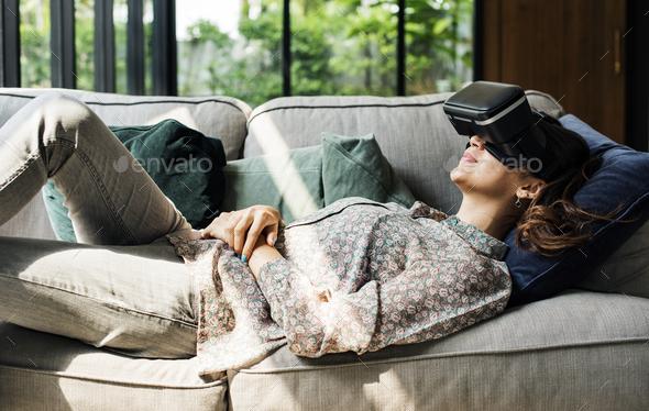 People enjoying virtual reality goggles - Stock Photo - Images