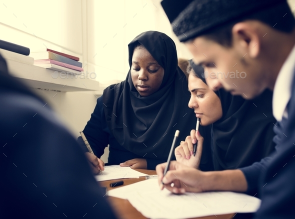 Diverse Muslim children studying in classroom - Stock Photo - Images