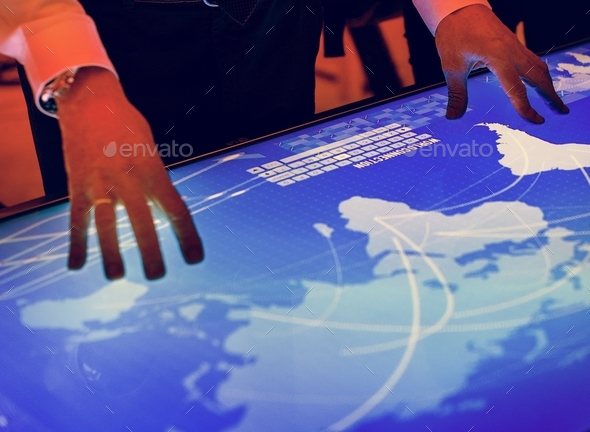 Hands touching a cyber space table screen - Stock Photo - Images