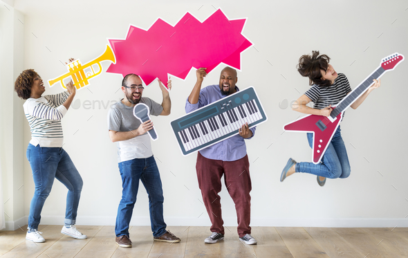 Group of diverse people enjoying music instruments - Stock Photo - Images