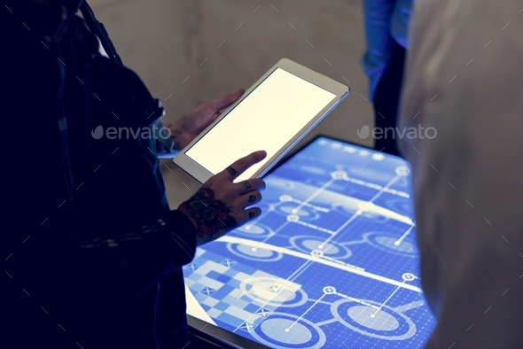 Hands holding using tablet at technology meeting - Stock Photo - Images