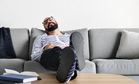 Man sleeping on the couch - Stock Photo - Images