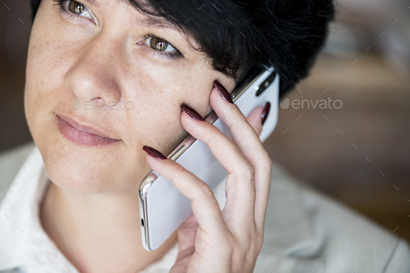 Woman making a phone call - Stock Photo - Images