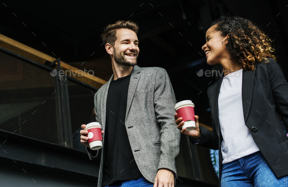 Business partners having take away coffee - Stock Photo - Images