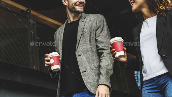 Couple having take away coffee together - Stock Photo - Images